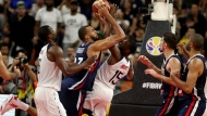 France's Rudy Gobert collides with United States' Kemba Walker, center during a quarterfinal match for the FIBA Basketball World Cup in Dongguan in southern China's Guangdong province on Wednesday, Sept. 11, 2019. (AP Photo/Ng Han Guan)