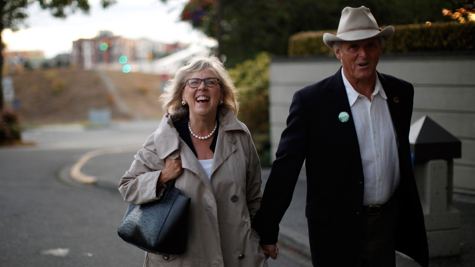 Green Party Leader Elizabeth May arrives with her husband John Kidder before announcing the official launch of the Green Party of Canada election campaign as she's joined by green candidates during a press conference at the Delta Hotels Victoria Ocean Pointe Resort in Victoria, B.C., on Wednesday, September 11, 2019. THE CANADIAN PRESS/Chad Hipolito