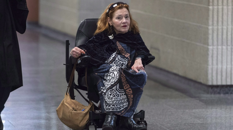 Nicole Gladu, who is incurably ill, arrives at the courthouse in Montreal on Monday, January 7, 2019, for the beginning of a trial challenging the provincial and federal laws on medically assisted death on the grounds they are too restrictive. THE CANADIAN PRESS/Paul Chiasson
