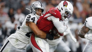 In this Thursday, Aug. 15, 2019 file photo, Oakland Raiders defensive back Johnathan Abram (24) tackles Arizona Cardinals running back David Johnson (31) during the first half of an an NFL football game in Glendale, Ariz.  (AP Photo/Ralph Freso, File)