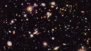 This image made available by the European Space agency shows galaxies in the Hubble Ultra Deep Field 2012, an improved version of the Hubble Ultra Deep Field image. A study from the Max Planck Institute in Germany published Thursday, Sept. 12, 2019, in the journal Science uses a new technique to come up with a rate that the universe is expanding that is nearly 18% higher than the number scientists had been using since the year 2000. (NASA, ESA, R. Ellis (Caltech), HUDF 2012 Team via AP)