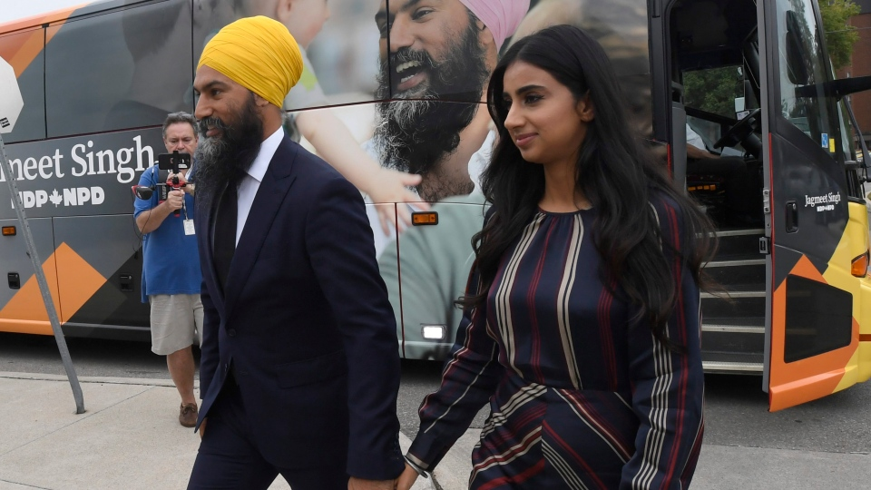 NDP Leader Jagmeet Singh and his wife Gurkiran Kaur Sidhu arrive for his campaign launch in London, Ont., Wednesday, Sept.11, 2019. THE CANADIAN PRESS/Adrian Wyld