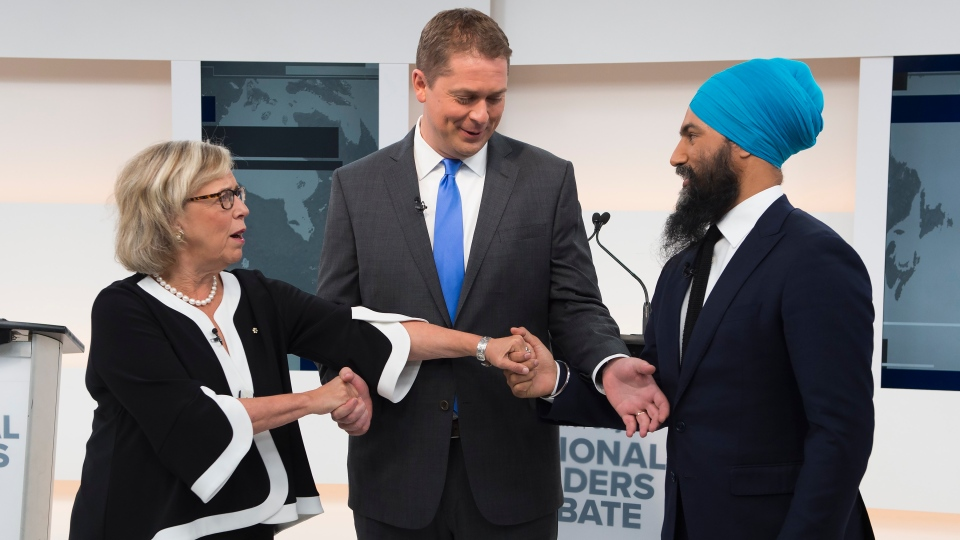 Green Party Leader Elizabeth May, left, Conservative Leader Andrew Scheer, centre, and NDP Leader Jagmeet Singh shake hands during the Maclean's/Citytv National Leaders Debate in Toronto on Thursday, Sept. 12, 2019. THE CANADIAN PRESS/Frank Gunn
