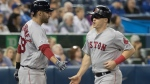 Boston Red Sox' Brock Holt comes in to score on a single by Xander Bogaerts in the seventh inning of their American League MLB baseball game against the Toronto Blue Jays in Toronto on Thursday, September 12, 2019. THE CANADIAN PRESS/Fred Thornhill