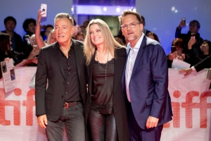 "Bruce Springsteen, left to right, Carolyn Blackwood and Thom Zimny arrive on the red carpet for the film ""Western Stars"" at the Toronto International Film Festival in Toronto on Thursday, September 12, 2019. THE CANADIAN PRESS/Chris Young"