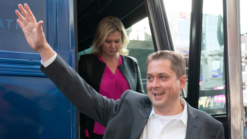 Conservative Leader Andrew Scheer waves to supporters as he arrives for the first election debate in Toronto, on Thursday, Sept. 12, 2019. THE CANADIAN PRESS/Paul Chiasson
