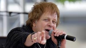 In this May 22, 2010 file photo, Eddie Money performs on the first day of qualifications for the Indianapolis 500 auto race at the Indianapolis Motor Speedway in Indianapolis. Family members have said Eddie Money has died on Friday, Sept. 13, 2019. (AP Photo/Darron Cummings)