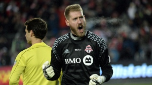 Toronto FC goalkeeper Clint Irwin (1) reacts after making a save against the Seattle Sounders during penalty kicks MLS Cup final action in Toronto on Saturday, Dec. 10, 2016. Toronto FC welcomes back former assistant coach Robin Fraser and goalkeeper Irwin on Sunday as the Colorado Rapids visit. Toronto looks to extend its unbeaten streak in all competitions to nine games.THE CANADIAN PRESS/Nathan Denette