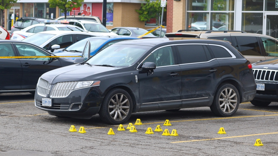 A car with bullet holes is seen in a plaza near Islington and Rexdale. (Tom Podolec)