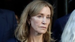 Actress Felicity Huffman leaves federal court after her sentencing in a nationwide college admissions bribery scandal, Friday, Sept. 13, 2019, in Boston. (AP Photo/Elise Amendola)