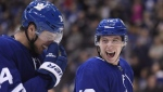 Toronto Maple Leafs right wing Mitchell Marner (16) and Toronto Maple Leafs centre Auston Matthews (34) laugh after Marner scored a goal against the Florida Panthers and fans threw hats onto the ice during third period NHL hockey action in Toronto on December 20, 2018. THE CANADIAN PRESS/Nathan Denette