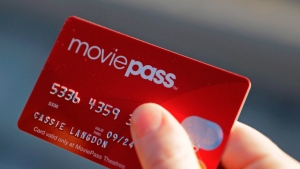 In this Jan. 30, 2018, file photo, Cassie Langdon holds her MoviePass card outside AMC Indianapolis 17 theatre in Indianapolis. (AP Photo/Darron Cummings, File)