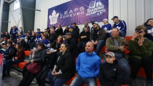 Fans watch the Toronto Maple Leafs practice at the training camp in Paradise, N.L., on Friday, Sept. 13, 2019. THE CANADIAN PRESS/Paul Daly