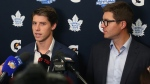 Toronto Maple Leafs Mitch Marner (left) and Leafs general manager Kyle Dubas are surrounded by media during a press conference at the Paradise Double Ice Complex in Paradise, NL on Saturday, September 14, 2019. Marner and the Maple Leafs have agreed on a new contract after a long off-season of negotiations. THE CANADIAN PRESS/Paul Daly