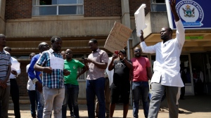 A group of Zimbabwean doctors protest at Parirenyatwa hospital in Harare, Zimbabwe, Sunday, Sept. 15, 2019. The Zimbabwe Hospital Doctors Association, which represents hundreds of junior doctors countrywide, said the association's president Peter Magombeyi was abducted on Saturday, days after receiving threats on his phone. (AP Photo/Themba Hadebe)