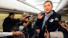 Conservative Leader Andrew Scheer scrums on a late night Federal Election flight from Ottawa to Vancouver on Sunday September 15, 2019. THE CANADIAN PRESS/Frank Gunn