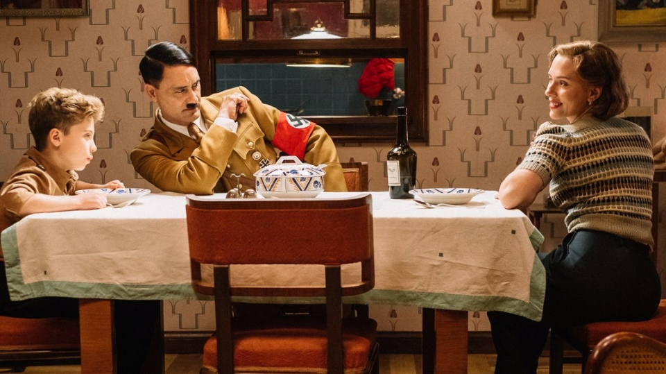 """Jojo (Roman Griffin Davis) has dinner with his imaginary friend Adolf (writer/director Taika Waititi), and his mother, Rosie (Scarlet Johansson) in a handout photo from the film """"Jojo Rabbit."""" The film has won the People's Choice Award at the Toronto International Film Festival. THE CANADIAN PRESS/HO-TIFF- Kimberley French MANDATORY CREDIT"""