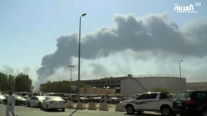 FILE - In this Saturday, Sept. 14, 2019 file photo, made from a video broadcast on the Saudi-owned Al-Arabiya satellite news channel, smoke from a fire at the Abqaiq oil processing facility fills the skyline, in Buqyaq, Saudi Arabia. The weekend drone attack on one of the world's largest crude oil processing plants that dramatically cut into global oil supplies is the most visible sign yet of how Aramco's stability and security is directly linked to that of its owner -- the Saudi government and its ruling family. (Al-Arabiya via AP, File)
