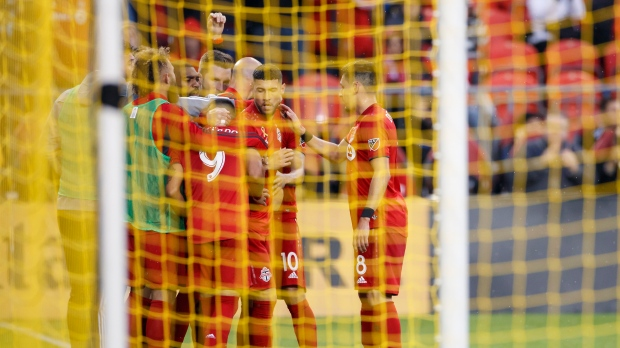 Toronto FC midfielder Jonathan Osorio (21), second from right, celebrates a goal with teammates during the second half of MLS action against the Colorado Rapids at BMO Field in Toronto, Sunday, Sept. 15 2019. THE CANADIAN PRESS/Cole Burston