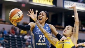 In this Aug. 30, 2017, file photo, Minnesota Lynx's Maya Moore, left, shoots against Indiana Fever's Jazmon Gwathmey during the first half of a WNBA basketball game in Indianapolis. Moore shocked the basketball world when she stepped away from the WNBA earlier in 2019 before the season began. She's spent a lot of her time away from the game trying to help a family friend, Jonathan Irons, get his conviction overturned. (AP Photo/Darron Cummings, File)