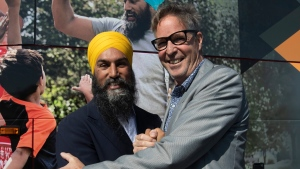 NDP leader Jagmeet Singh and Eric Ferland pose for photographers after an announcement in Longueuil, Que. Monday September 16, 2019. Singh announced Ferland would run for the NDP in the riding of Longueuil-Saint-Hubert. THE CANADIAN PRESS/Adrian Wyld