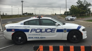 A Peel Regional Police cruiser is shown at the scene of a deadly shooting investigation on Highway 410 in Brampton on Monday afternoon. (Steve Ryan)