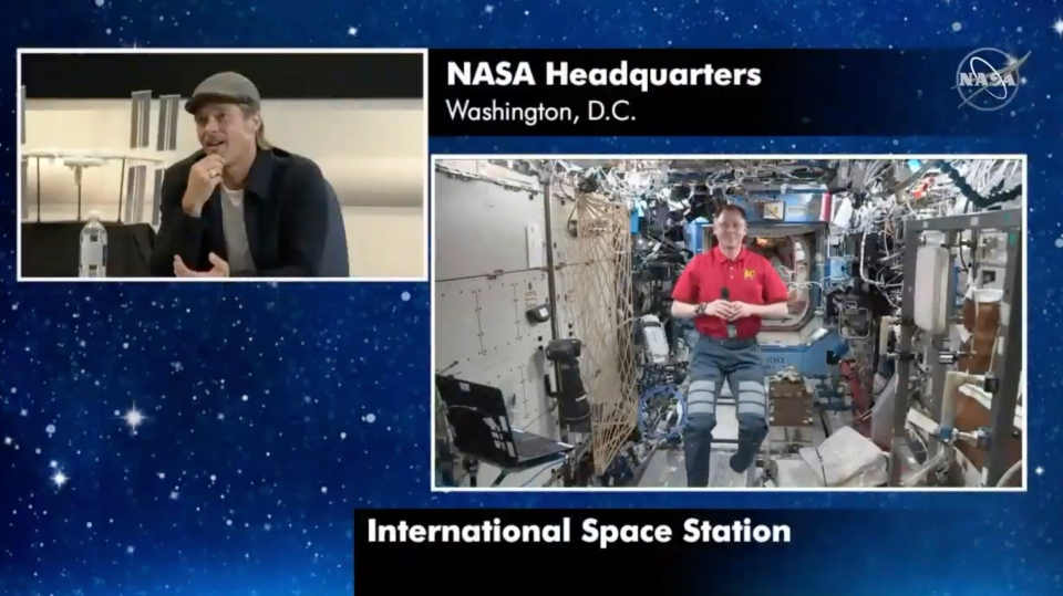 "In this image taken from NASA video actor Brad Pitt, left, star of the new space movie ""Ad Astra,"" speaks from NASA headquarters in Washington, to astronaut Nick Hague abroad the International Space Station, on Monday, Sept. 16, 2019. (NASA via AP)"