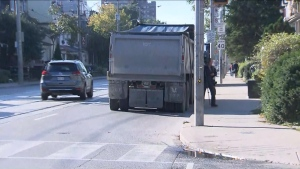 A dump truck that struck a pedestrian in the city's Harbord Village neighbourhood on Tuesday morning is shown.