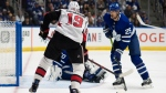 Ottawa Senators forward Drake Batherson battles Toronto Maple Leafs defenceman Kevin Gravel for the puck during third period NHL preseason action in St. John's, N.L. on Tuesday, Sept. 17, 2019. THE CANADIAN PRESS/Joe Chase