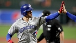 Toronto Blue Jays' Cavan Biggio is greeted by Bo Bichette after he scored both of them with a two-run home run off Baltimore Orioles starting pitcher Chandler Shepherd during the third inning of a baseball game, Tuesday, Sept. 17, 2019, in Baltimore. (AP Photo/Julio Cortez)
