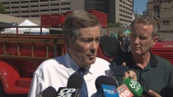 Mayor John Tory speaks with reporters at Nathan Phillips Square on Tuesday afternoon.