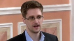 In this Oct. 11, 2013 file image made from video and released by WikiLeaks, former National Security Agency systems analyst Edward Snowden speaks in Moscow. (AP Photo, File)