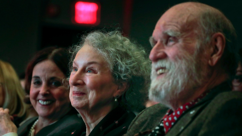 In this March 16, 2017 file photo, author Margaret Atwood, center, appears with her editor Nan Talese, left, and husband Graeme Gibson as she is introduced for the Ivan Sandrof Lifetime Achievement Award at the National Book Critics Circle awards ceremony in New York. (AP Photo/Julie Jacobson, File)