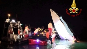 This image provided by firefighters shows the wreckage of a racing boat that allegedly smashed into a dam at the entrance of the Venice laguna, Italy, late Tuesday, Sept. 17, 2019. Firefighters said one of the men on board was thrown off the boat and was taken to the hospital, the bodies of the three others were found by scuba-divers inside the cabin. According to the Italian news agency ANSA, the men were attempting to break the racing boat record for Montecarlo to Venice and among the dead was 76-year-old Italian boat racing pilot Fabio Buzzi. (Italian Firefighters via AP)