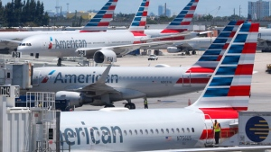 In this April 24, 2019, photo, American Airlines aircraft are shown parked at their gates at Miami International Airport in Miami. A bail hearing is scheduled for a mechanic charged with sabotaging an American Airlines jetliner as part of a labor dispute. Prosecutors are seeking pretrial detention for 60-year-old Abdul-Majeed Marouf Ahmed Alani at a hearing Wednesday, Sept. 18. (AP Photo/Wilfredo Lee, File)