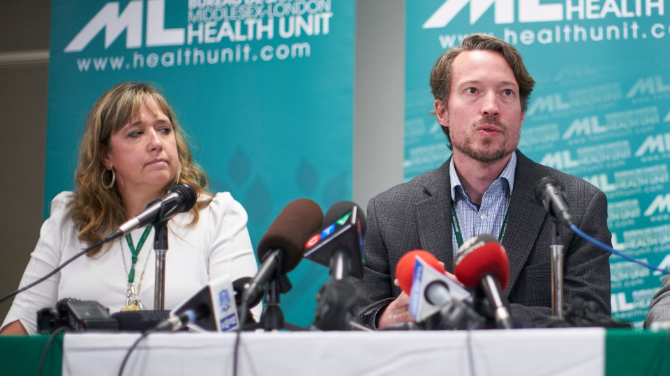 Dr. Chris Mackie, Medical Officer and CEO of Health for the Middlesex-London Health Unit speaks during a press conference in London, Ont., Wednesday, September 18, 2019 as Linda Stobo, manager, Chronic Disease and Tobacco Control at the unit looks on. The announcement involved the first known case in Canada of severe pulmonary illness linked to vaping. THE CANADIAN PRESS/Geoff Robins