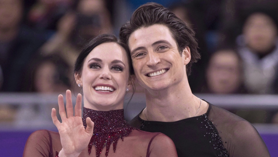 Ice dance gold medallists Canada's Tessa Virtue and Scott Moir look up to the crowd during victory ceremonies at the Pyeongchang Winter Olympics Tuesday, February 20, 2018 in Gangneung, South Korea. On Friday, Virtue and Moir were rewarded for their historic comeback performance at the Pyeongchang Olympics by winning the The Canadian Press team of the year for 2018. THE CANADIAN PRESS/Paul Chiasson