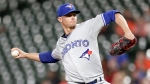 Toronto Blue Jays starting pitcher Clay Buchholz throws to a Baltimore Orioles batter during the first inning of a baseball game, Wednesday, Sept. 18, 2019, in Baltimore. (AP Photo/Julio Cortez)