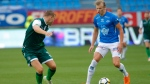 Ryan Porteous of Hibernian, left, in action with Erling Braut Haaland of Molde FK, during their Europa League Qualification soccer match at Aker stadium in Molde, Norway, Thursday Aug. 16, 2018.  (Svein Ove Ekornesvaag / NTB scanpix