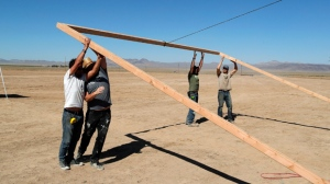 "Workers erect a stage at the Little A'Le'Inn on Wednesday, Sept. 18, 2019, in Rachel, Nev. No one knows what to expect, but lots of people are preparing for ""Storm Area 51"" in the Nevada desert. Events include an ""Area 51 Basecamp"" in Hiko featuring music, speakers and movies and dueling ""Alienstock"" festivals. One is Thursday through Sunday in Rachel, and another is Thursday in Las Vegas. (AP Photo/John Locher)"