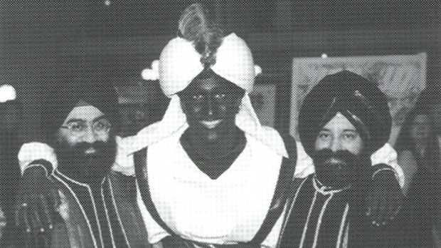 "Justin Trudeau is seen in brownface, wearing a turban, while embracing two Sikh men at a gala in 2001. (West Point Grey Academy newsletter titled ""View Point"" from April 2001)"
