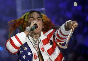 In this Sept. 21, 2018, file photo rapper Daniel Hernandez, known as Tekashi 6ix9ine, performs during the Philipp Plein women's 2019 Spring-Summer collection, Milan, Italy. (AP Photo/Luca Bruno, File)