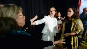 Independent candidates Jody Wilson-Raybould, right, and Jane Philpott, centre, and Green Party Leader Elizabeth May hug following an election campaign event for Wilson-Raybould in Vancouver on Wednesday, Sept. 18, 2019. THE CANADIAN PRESS/Jonathan Hayward