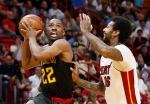 Atlanta Hawks guard Isaiah Taylor (22) drives against Miami Heat forward James Johnson (16) during the second half of an NBA basketball game Tuesday, April 3, 2018, in Miami. (AP Photo/Wilfredo Lee)