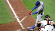 Toronto Blue Jays' Cavan Biggio hits a solo home run off Baltimore Orioles starting pitcher Gabriel Ynoa during the fourth inning of a baseball game Thursday, Sept. 19, 2019, in Baltimore. (AP Photo/Julio Cortez)