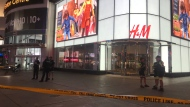 Police are seen at the Eaton Centre entrance after a shooting on Sept. 19, 2019. (Mike Nguyen/CP24)