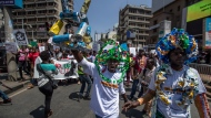 Around a thousand protesters, some wearing outfits made from plastic bottles and bottle-tops to raise the issue of plastic pollution, march to demand action on climate change, in the streets of downtown Nairobi, Kenya Friday, Sept. 20, 2019. Protesters around the world joined rallies on Friday as a day of worldwide demonstrations calling for action against climate change began ahead of a U.N. summit in New York. (AP Photo/Ben Curtis)