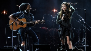 "This Jan. 16, 2019 file photo shows Toni Cornell, right, daughter of the late singer Chris Cornell, performing with Ziggy Marley during ""I Am The Highway: A Tribute to Chris Cornell"" in Inglewood, Calif. (Photo by Chris Pizzello/Invision/AP, File)"