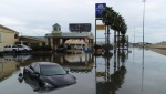 Several cars were flooded along Interstate 10 in Southeast Texas, Thursday, Sept. 19, 2019, due to Tropical Storm Imelda. The National Weather Service says Imelda is the seventh-wettest tropical cyclone to strike the 48 contiguous United States on record. (Guiseppe Barranco/The Beaumont Enterprise via AP)