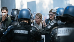 A woman gestures as she speaks with riot police officers during a yellow vests demonstration, in Paris, Saturday, Sept 21. 2019. Paris police have used tear gas to disperse anti-government demonstrators who try to revive the yellow vest movement in protest at perceived economic injustice and French President Emmanuel Macron's government. The French capital was placed under high security as few hundred anti-government protesters started marching in the Paris streets. (AP Photo/Kamil Zihnioglu)